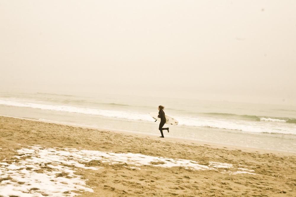 Snap shot  Surfer dude at my beach outside Bryne/Stavanger winter.