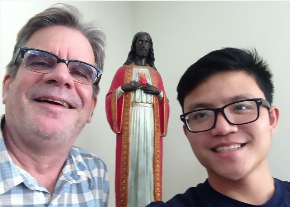 "Fr. Matt and Fr. Quang with their favorite ""idol,"" the Sacred Heart."