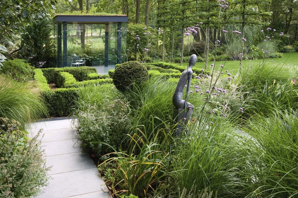 A Diverse Family Garden Complements An Imposing Modern Residence In Kingston Hill Surrey Juxtaposing L Shapes Defined With Slate