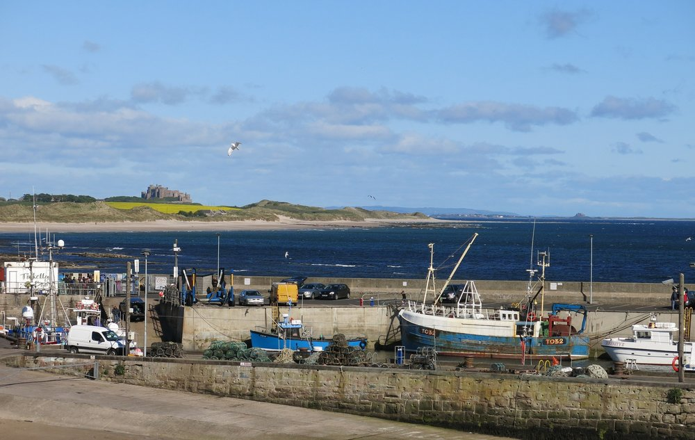 bamburgh-castle-viewed-from-Seahouses--pixabay-883746_1920.jpg