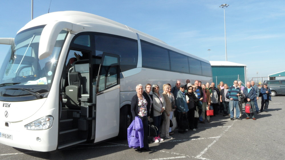 Coach with passengers outside