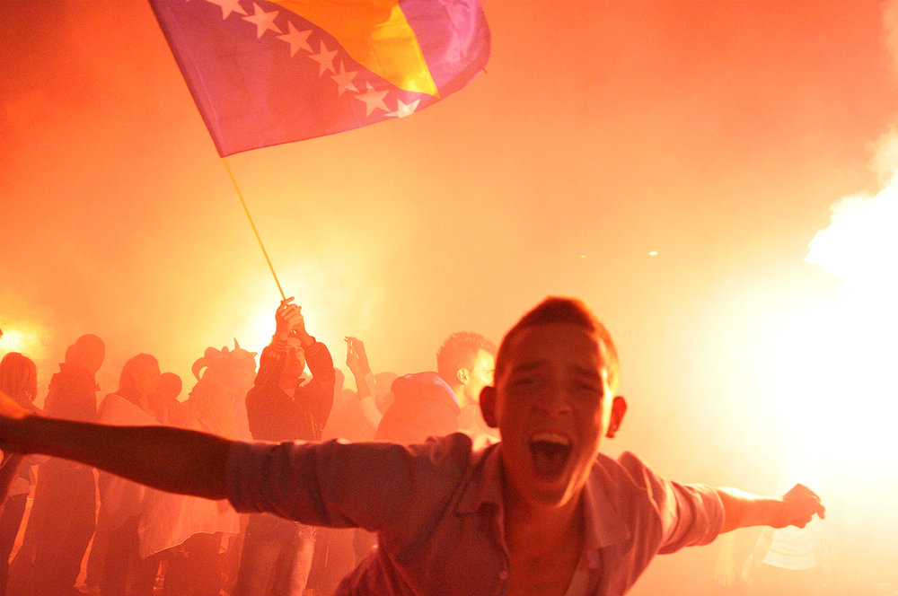 Supporters of Bosnia and Herzegovina's national football team, celebrate at one of city squares in Sarajevo after watching the public live broadcast of the final World Cup 2014 qualifier match between Bosnia and Lithuania, played in Kaunas, Lithuania. Bosnian team won the match 1-0 and successfully qualified for the World Cup 2014 in Brasil.