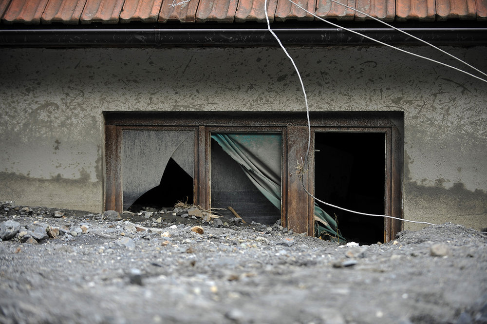 Window of a house wich is buried in mud and rubble after a landslide at the village of Topcic Polje , near Zenica.
