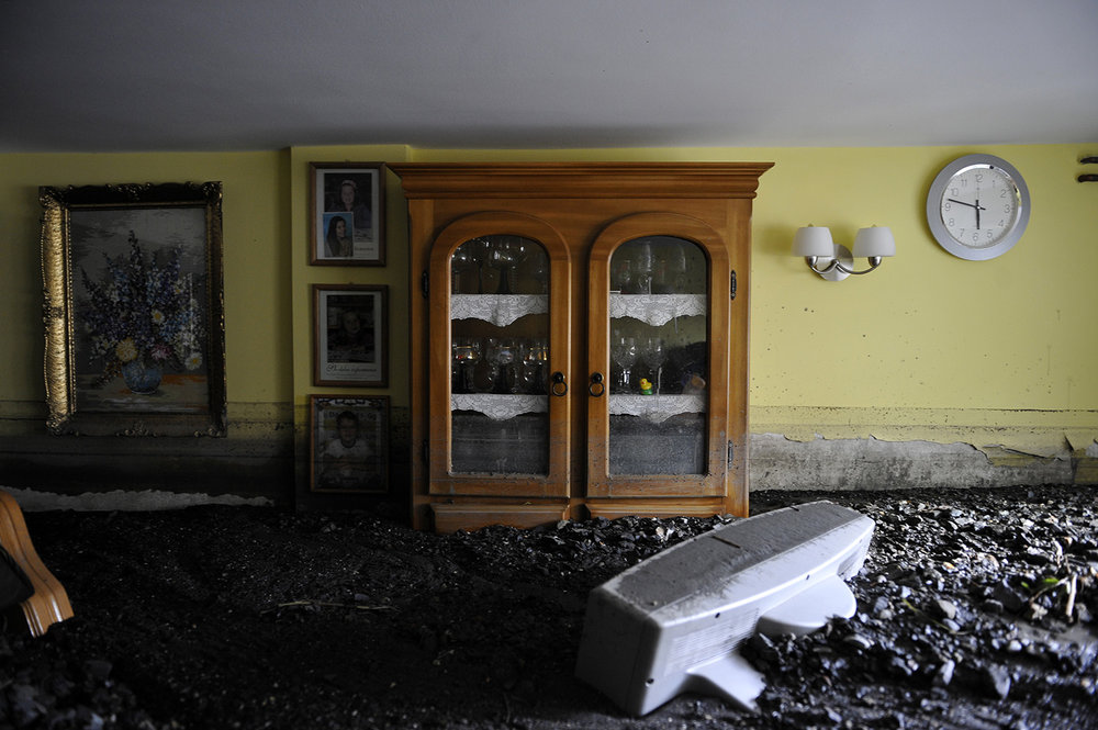 Furniture in the living room of a house wich is buried in mud and rubble after a landslide at the village of Topcic Polje , near Zenica.