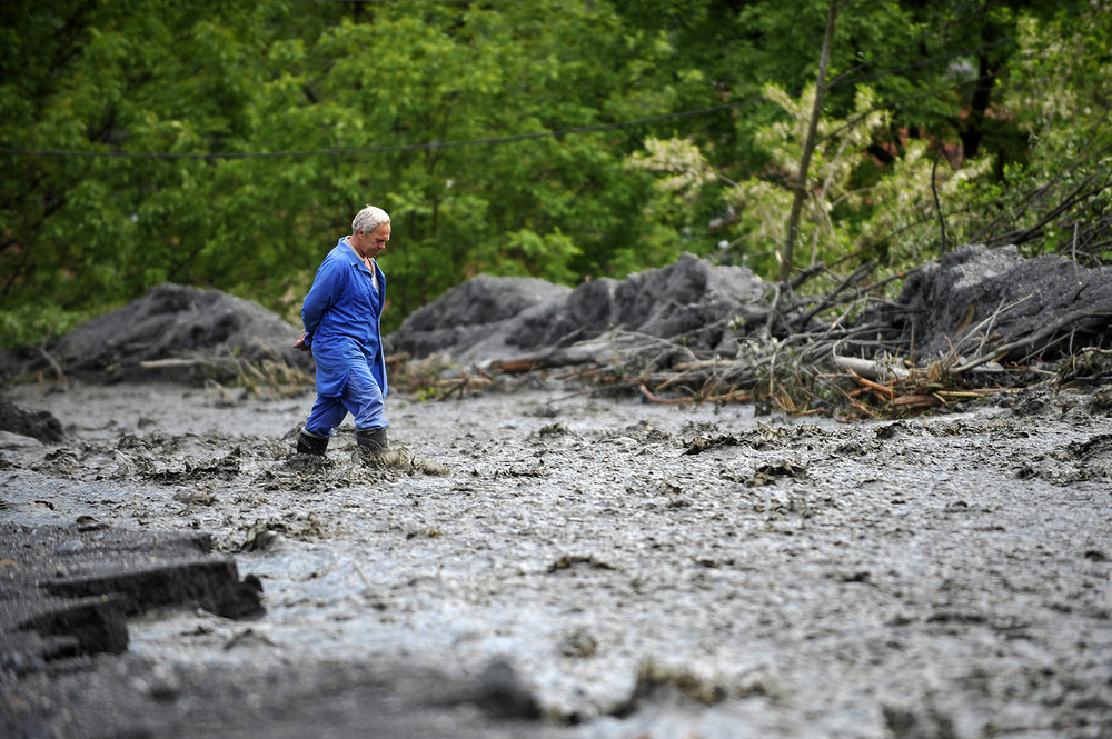 A man passes through the floodwaters area in the village of Topcic Polje near Zenica.