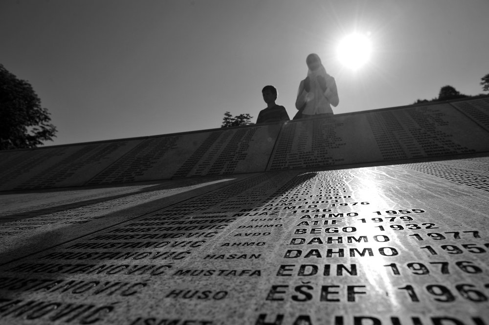 A woman prays next to the name of Srebrenica victims in the Potocari Memorial Centre, near Srebrenica, Bosnia and Herzegovina.This year is the 20th anniversary of the Srebrenica genocide. Twenty years ago, brothers, sons, husbands, and fathers were torn from their families. They were savagely murdered in the largest massacre in Europe in a half-century.