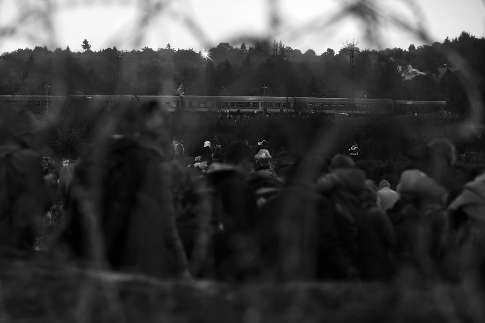 View through barbed wire on the train the Hungarian police. Several thousand refugees arrived in Croatia and started to walk towards the Hungarian border, where they will continue to travel by train to Austria. Most refugees want to get to Germany.  All Hungarian border will be closed after a few hours.
