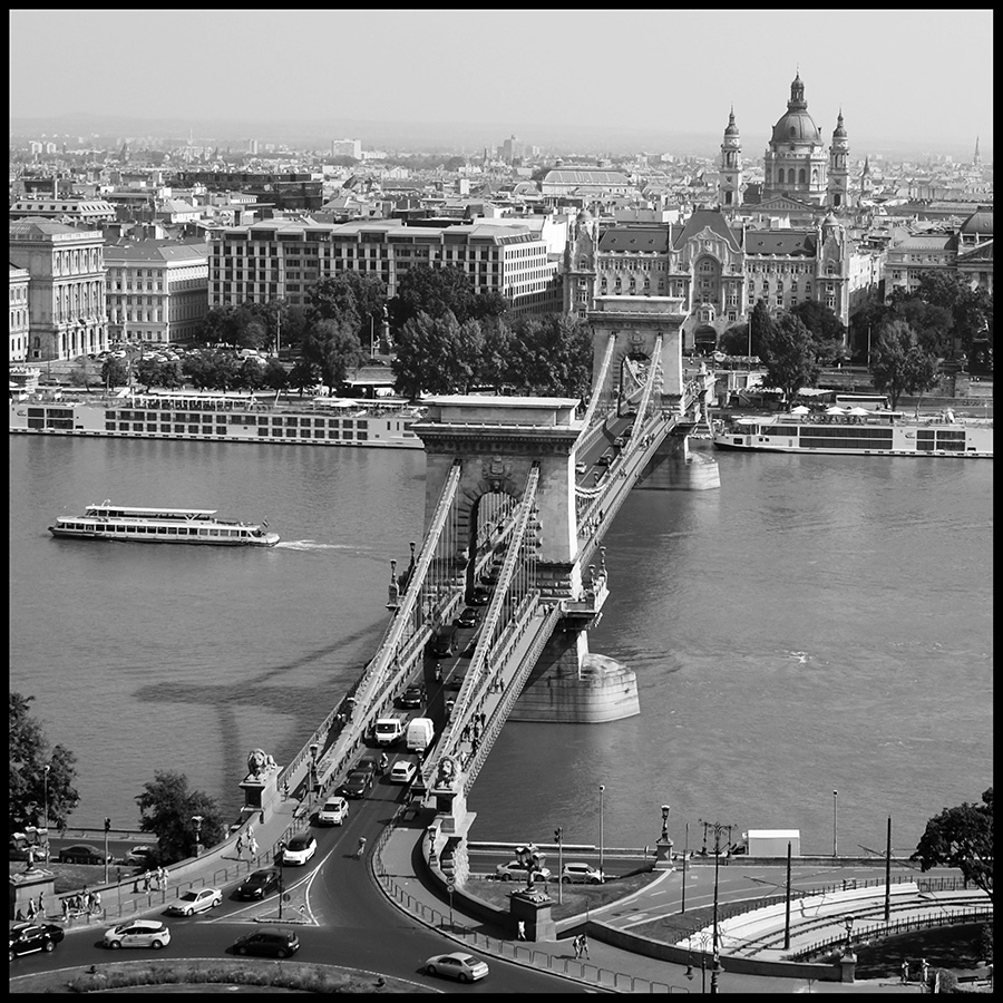 View of Széchenyi Chain Bridge. This twin-towered span is the oldest and arguably the most beautiful bridge over the Danube. It is named in honour of its initiator, István Széchenyi, but was built by a Scotsman named Adam Clark. When it opened in 1849, Széchenyi Chain Bridge was unique for two reasons: it was the first permanent dry link between Buda and Pest, and the aristocracy, previously exempt from all taxation, had to pay the toll.