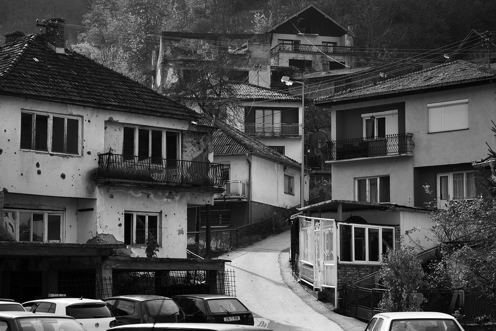 View of destroyed and reconstructed houses in the center of Srebrenica. The first returnees came back in 2000, but only a few thousand returned in the next few years.