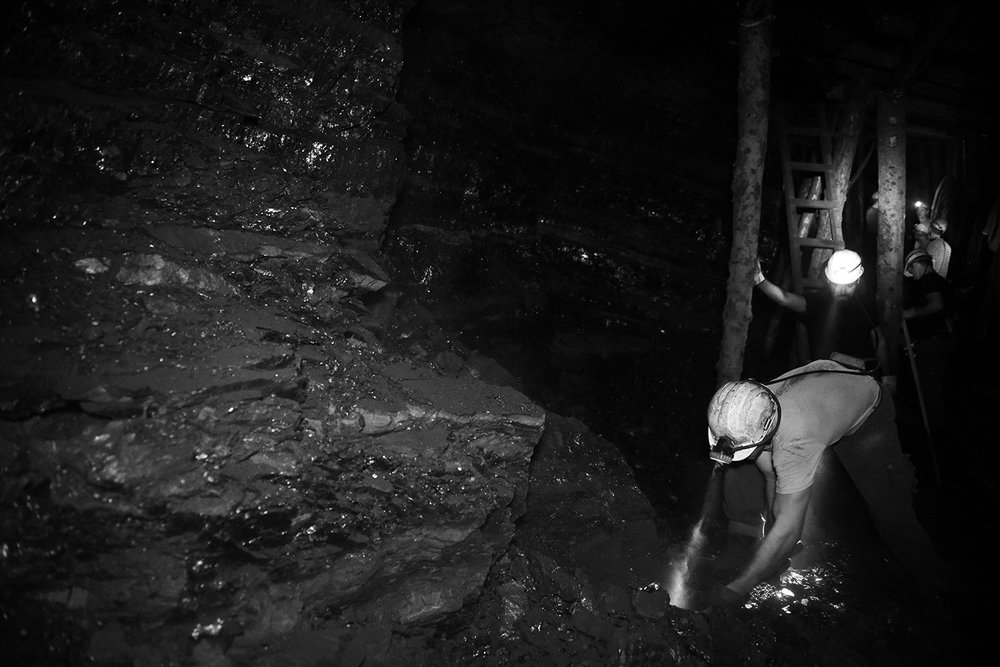 Coal miners prepare work site and manually dig coal at a depth of 350 meters.Today there are machines that extraction of coal make it easier, but in many places in the coal mine they still work the old-fashioned way.