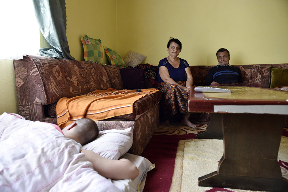 The Avdagic family sits together in a 30m2 apartment in the Belvedere collective center for displaced people located in Bosnian town of Goražde. They've now been living here with their three children for over 20 years as they are unable to return to their pre-war home in the entity of Republika Srpska.