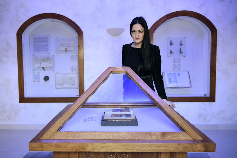 Lea Maestro, a young Bosnian Jewish women standing behind the Haggadah in the National Museum of Bosnia and Herzegovina. Lea, who represents a national minority, is one of many young people planning to leave Bosnia because of low living standard, a weak economy, low and irregular salaries and the fact that the country about 60% of the unemployed is devastating. Sarajevo, Bosnia and Herzegovina.