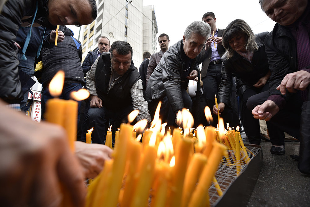 Family members light candles for the souls of their loved one who were killed in the Dobrovoljacka Street attack in Sarajevo in 1992. Bosnia and Herzegovina