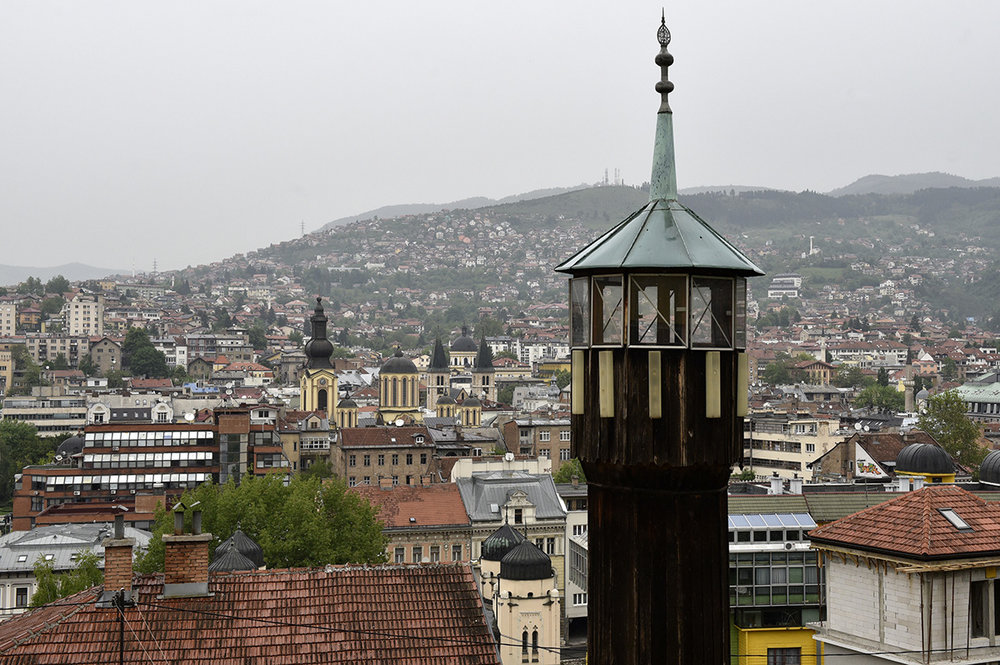 "A view of the Bosnian capital city of Sarajevo. A Mosque, Cathedral, Church and Synagogue stand within 100 meters of one another. Due to its religious and cultural diversity, Sarajevo is often heralded as the ""European Jerusalem"". Bosnia and Herzegovina"