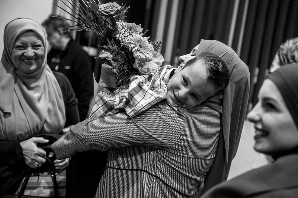 Hug of Ismail and kindergarten teacher Nisveta Kozlic
