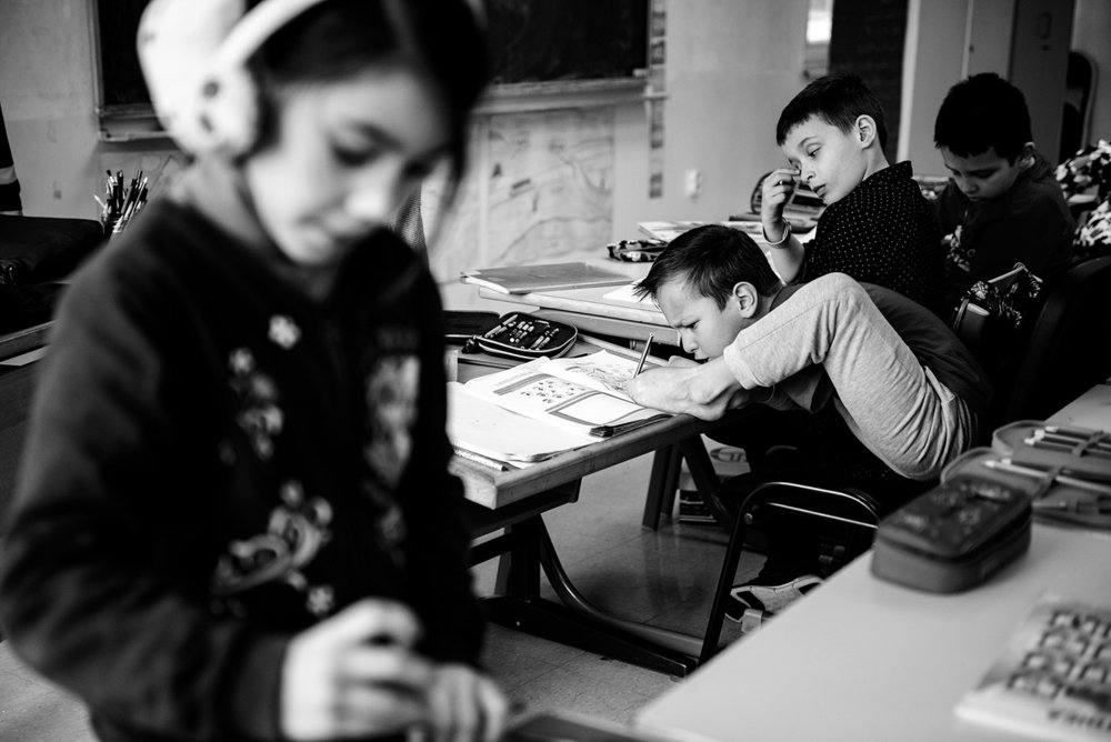 Ismail is doing the task he got from a teacher during class in elementary school Hasan Kjafija Pruscak in Zenica.
