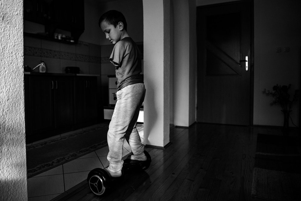Ismail shows how skillfully he drives a hoverboard in his home in Zenica.