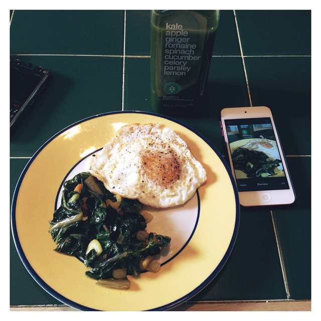 First meal of the day: Sunny side up egg with sautéed Swiss green chard with chunks of garlic, turmeric, and ginger. Drinking green. #blueprint #BPCleanse #GreenJuice #Kale #Apple #spinach #ginger #romaine #cucumber #celery #Parsley #lemon #garlic #swisschard #turmeric #ginger #eggs #greenchard #eatnaturally #thecitruslife