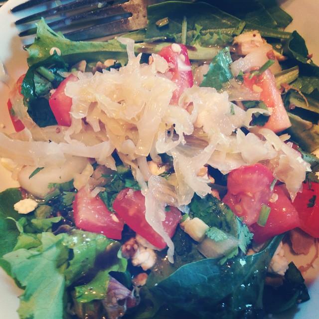 When I add raw organic sauerkraut to my salads, I am always in heaven. #tomatoes #cilantro #spinach #mesclun #mixedgreens #onion #sauerkraut #raw #organic #salad #livehappily #eatnaturally #love #chicken #roasted