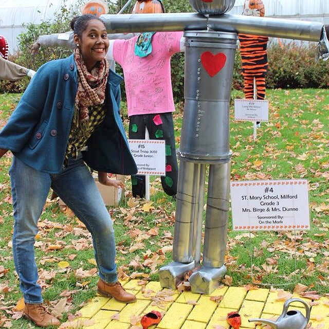 Standing next to the tin man pumpkin on the yellow brick road. #BooAtTheZoo #family #familytime #twinning #livehappily #Halloween #HappyHalloween