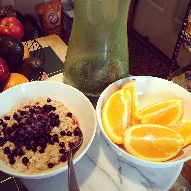 Brunch for a sick girl. #frozen #blueberries #glutenfree #oatmeal #coconutoil #oranges #greenjuice #eatclean #eatnaturally #thecitruslife