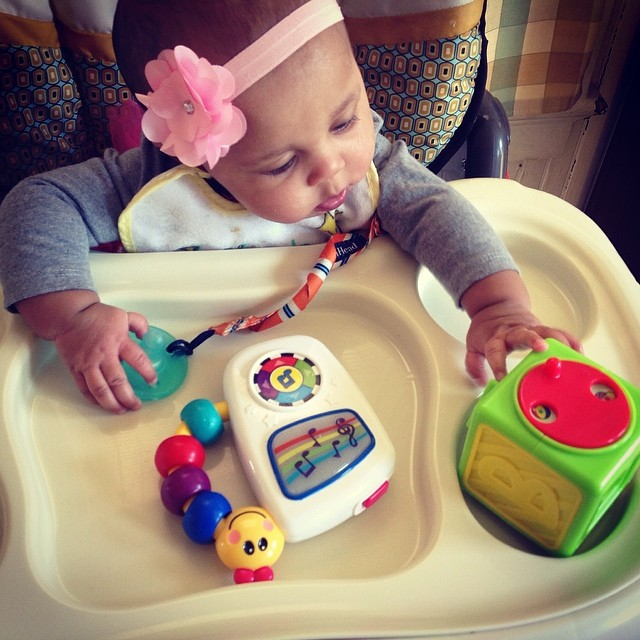 Yes honey, that is a block. She's developed this new habit of yelling at her toys. I blame the parents, lol. #baby #babytime #babyblocks #blocks #habit #toys #highchair #babyeinstein #livehappily #connect #thecitruslife