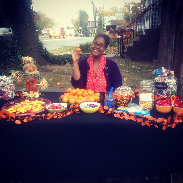 Our candy table before the crazy candy rush. Yes, I am holding a pumpkin face tangerine which went VERY quickly! #livehappily #happyhalloween