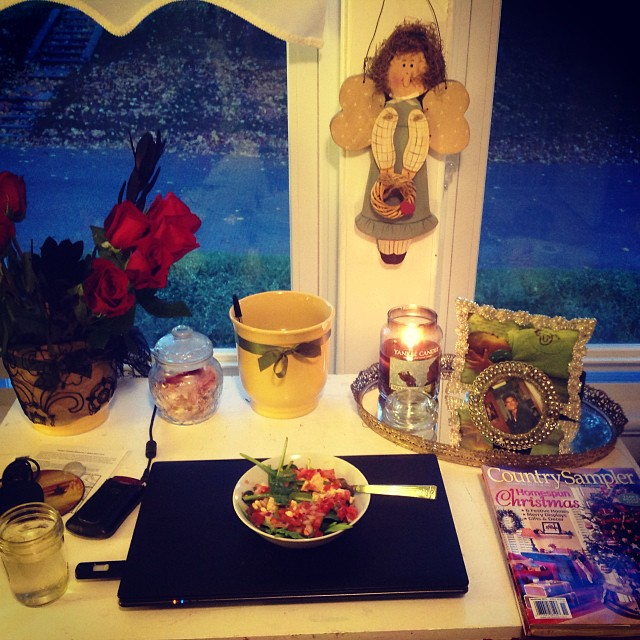 """My little haven of creativity that I set up in the nursery. The mirrored tray and jeweled photo frames give the desk a girly chic-ness while the """"Warm Woolen Mittens"""" Yankee Candle usher in holiday warmth. Love my Halloween roses with black filler plants. #homeoffice #warmth #yankeecandle #nursery #livehappily #thecitruslife"""
