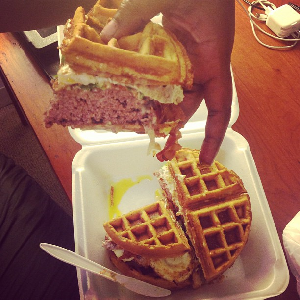 A giant burger sandwiched between waffles with 3 fried eggs, cheese, and more. With a side of one pound fries. This was crazy and I think they only ate ¼ of it. My #HippieSalad was awesome. Definitely a #ManVersusFood challenge. #OhNoYouDidntBurger #box63 #newhaven