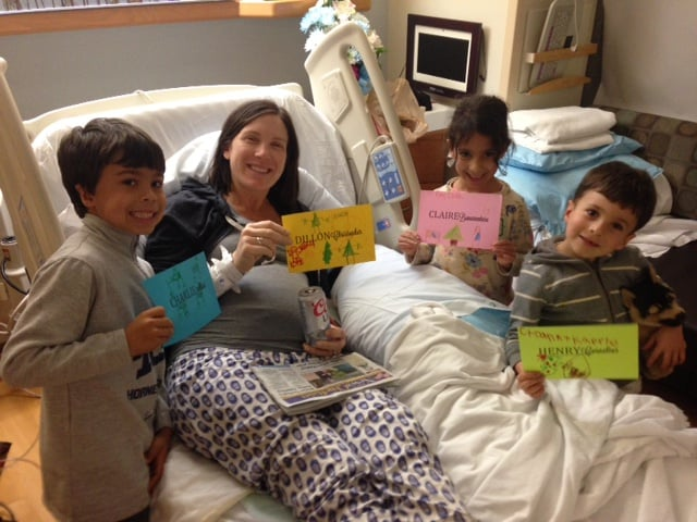 NICU isolette nametags made by the quads cousins with a well-deserved postpartum Coors Light for mama.