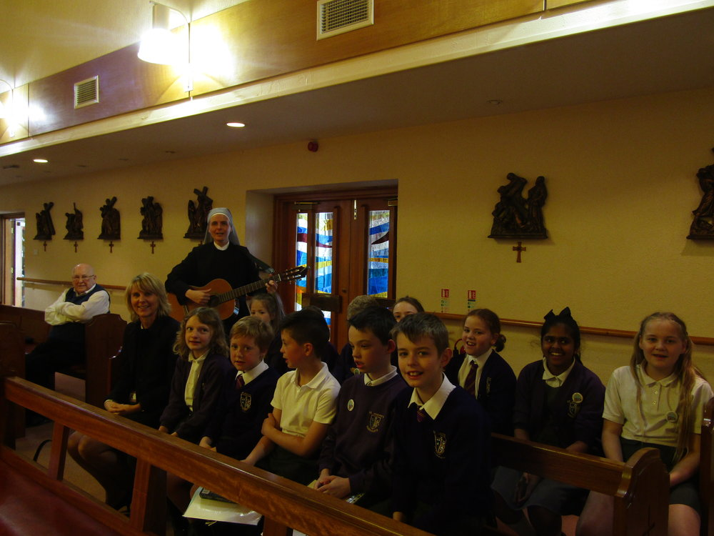 Mini Vinnies singing with Mother Caroline at the chapel at the Little Sisters in Headingley