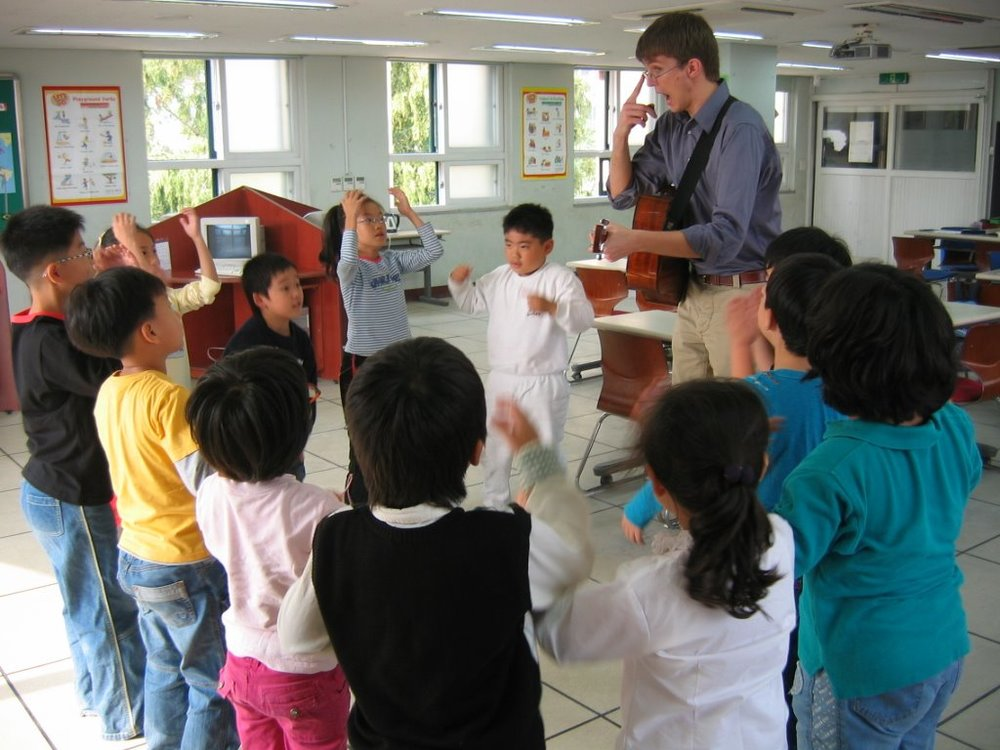 Austin having fun with a group of Korean kids.