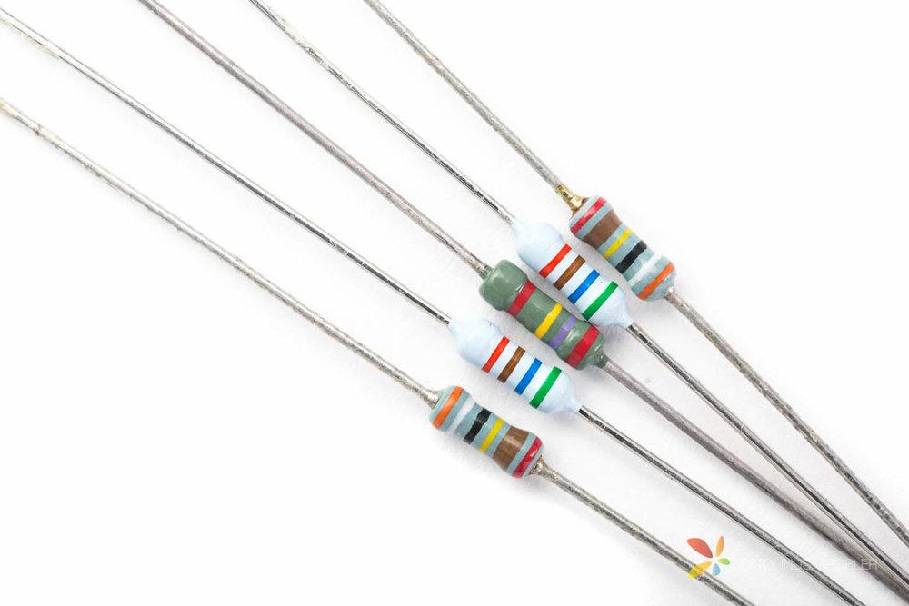 5 Resistors on white background