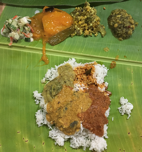 You have to try the banana leaf rice. It is South Indian style and has many different kinds of curries you can use on the rice. Also dahl and other tasty vegetables to accompany.