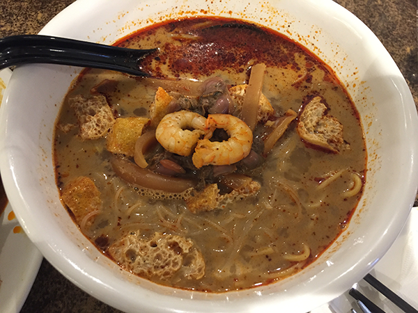 Curry laksa soup. Another delicious dish which is a curry dish that has seafood, tofu, cuttlefish and two types of noodles. It's spicy and delicious! A must try for Chinese food in Kuala Lumpur.