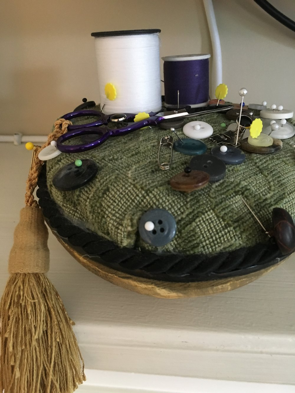 An adorable way to leave an old-world sewing kit on the mantle for guests