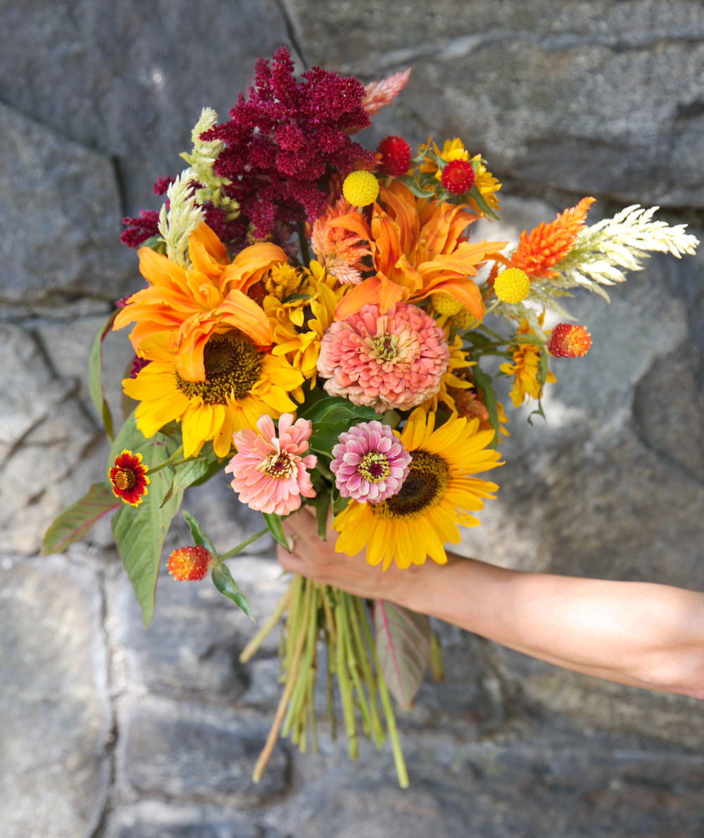 Loved the peaches and oranges in this bouquet (found a great stone wall as backdrop)