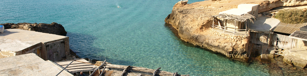 "the little ""calas"" of Crystal clear water and tucked away fishermen's boats."