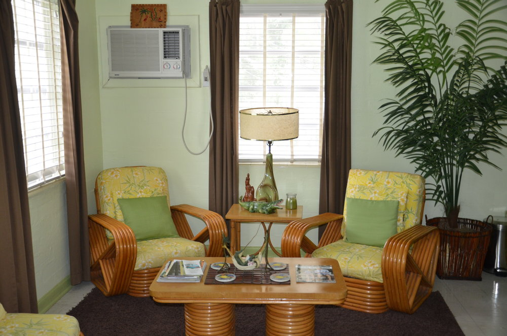 The alligator suite - Starting at $150 per nightA totally 50's Florida experience. The sitting area and bedrooms are furnished with original vintage rattan in a true Florida, tropical style. This unit has 2 separate sleeping areas with queen size beds and bathroom with a walk in shower. The kitchenette is fully equipped. The Alligator Suite is upstairs and offers a balcony sitting area. This unit is especially good a party of four.