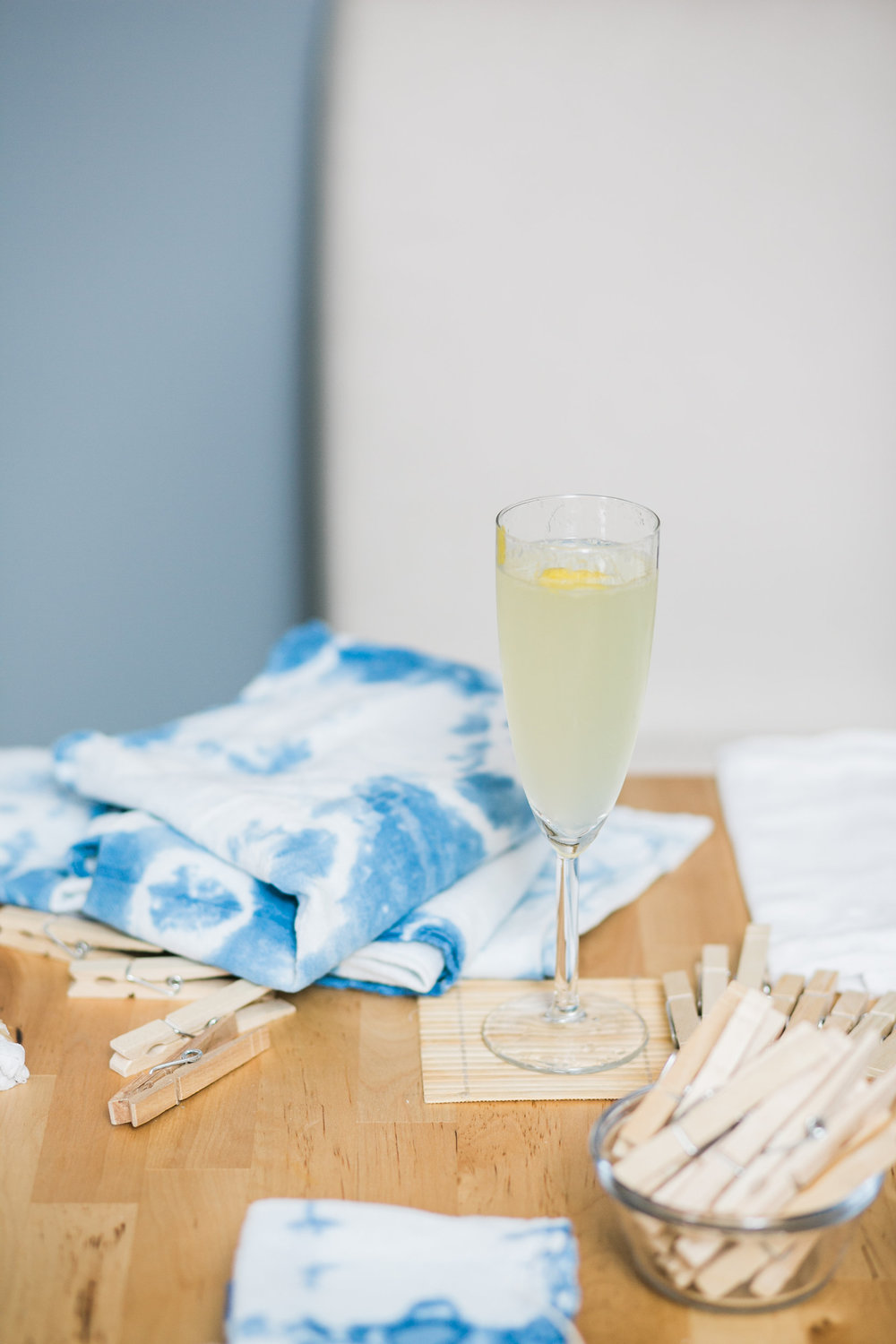 A finished Shibori-dyed tea towel and French 75. Photo by Jen Eun.