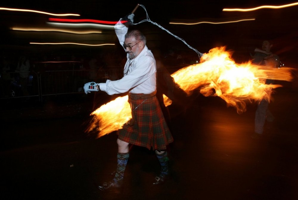 Hogmanay fireball swingers illuminate the streets of Stonehaven carrying on the tradition of welcoming the new year in Scotland.