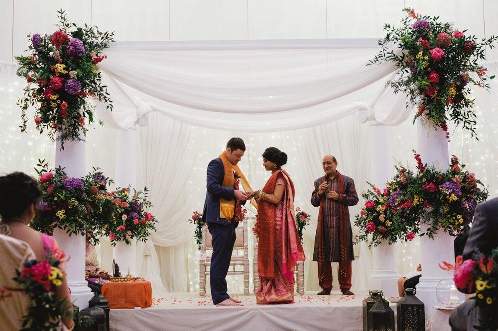 Preeti&Barry mandap 3 holding hands.jpg