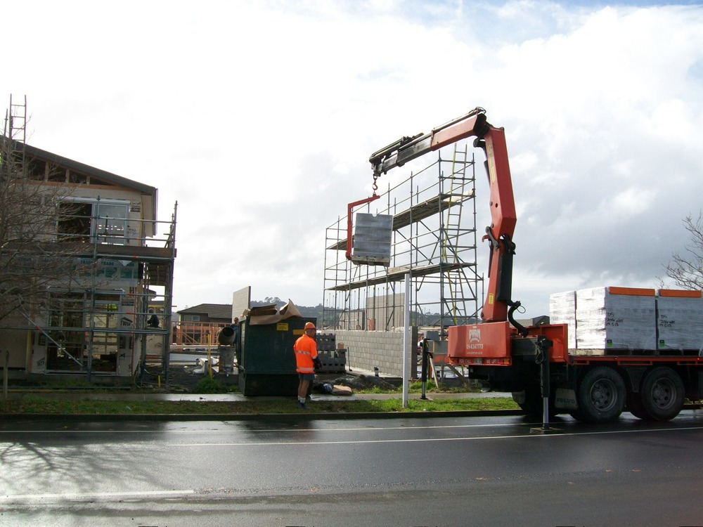 8x4 hiab placing pallet of blocks on site with fork attachement.jpg
