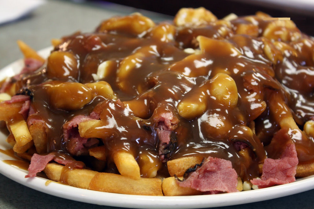 In addition to hitting a brewery, avail yourself of local #carbtown delicacies, such as Canada's poutine