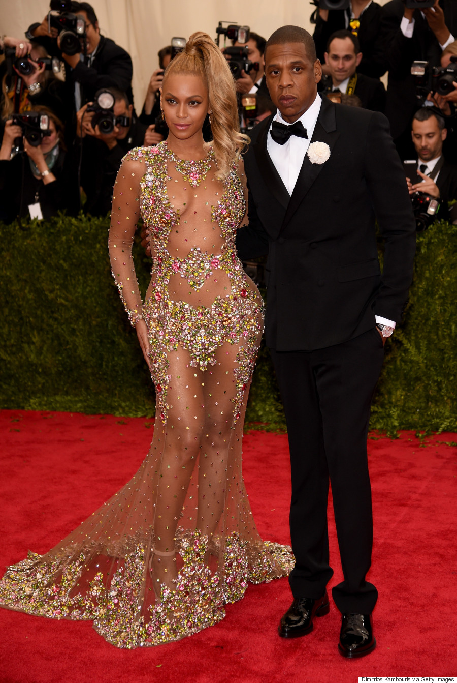 Beyonce in Givenchy Haute Couture, Jay-Z in Givenchy, 2013 *via Getty Images*