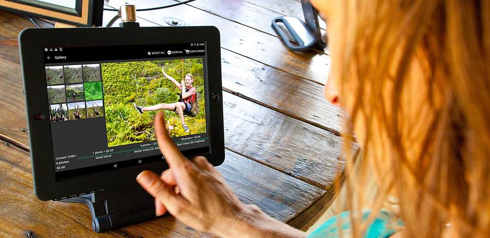 A customer views and purchases her images at Kualoa Ranch, a zipline operation in Hawaii.