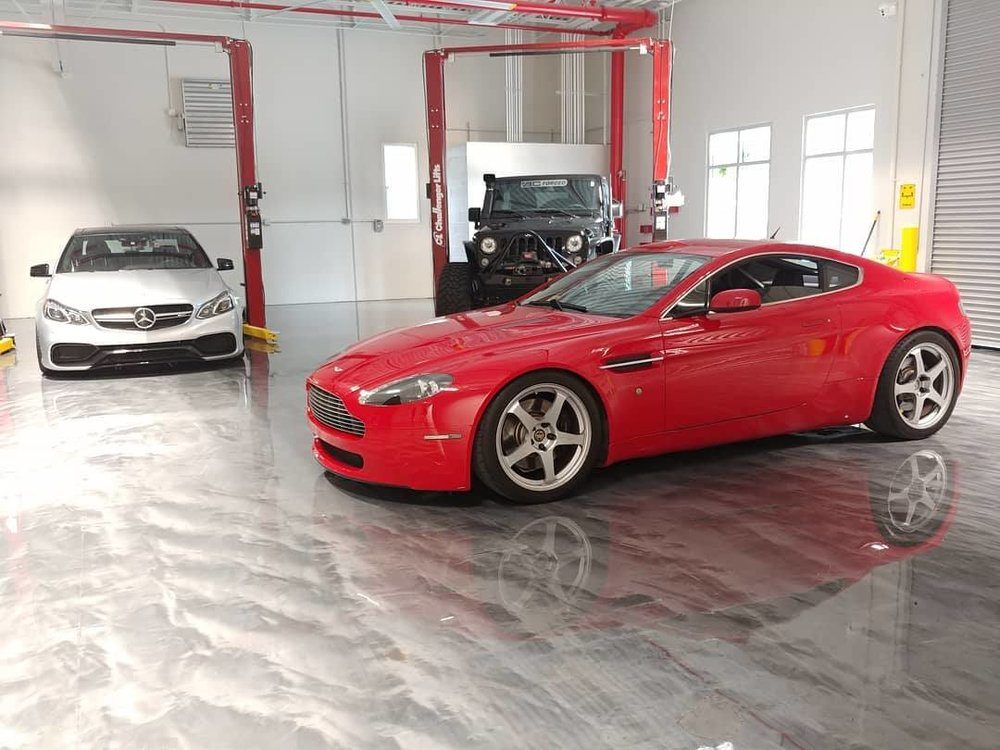 Our red V8 Vantage with BC Racing coilovers at their North American HQ.