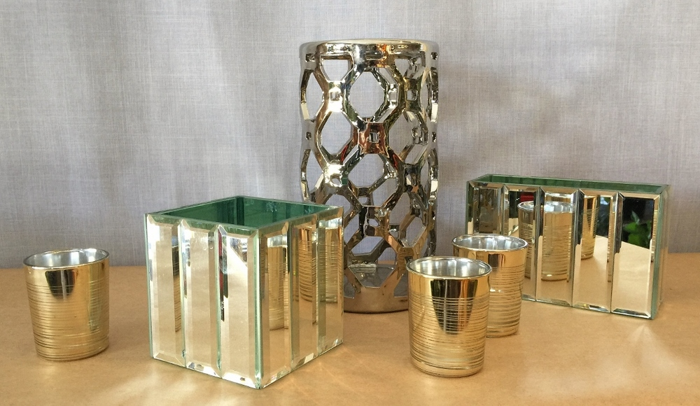 Collection of silver containers and candles holders