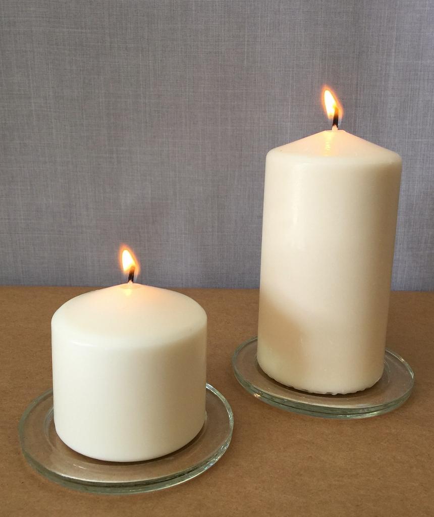 Pillar candles with glass saucer