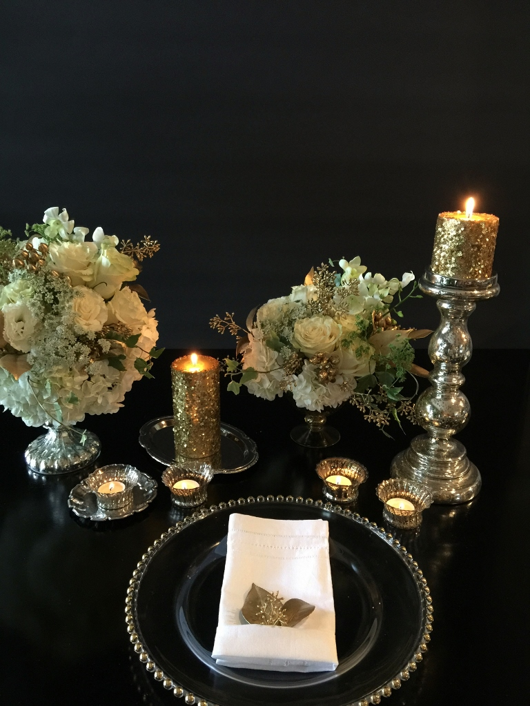 Collection of mercury, glass, candleholders and gold beaded charger